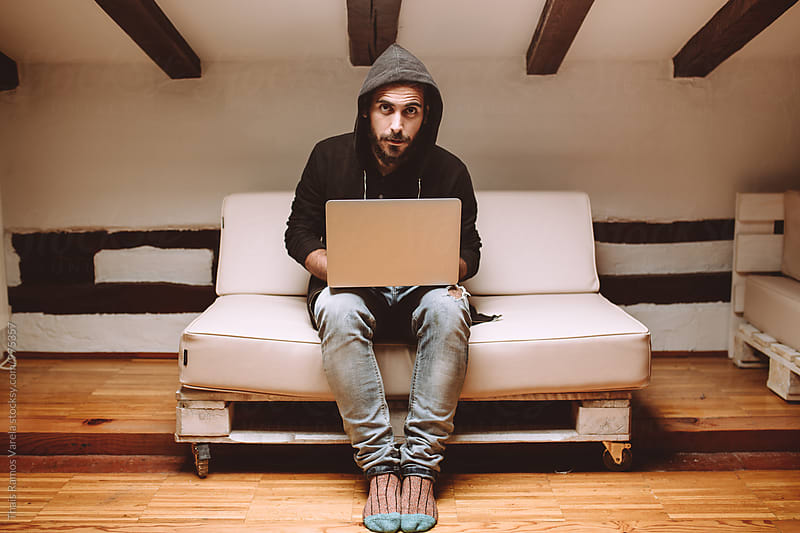 man working with a laptop by Thais Ramos Varela for Stocksy United