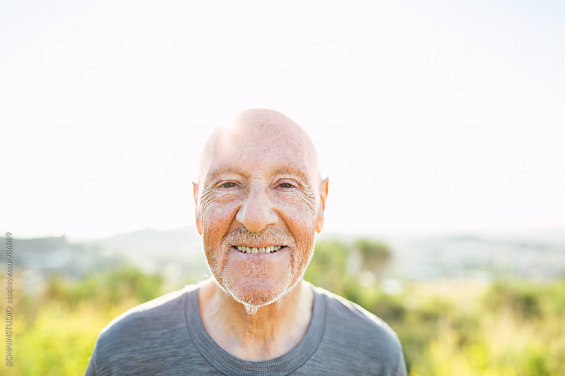 Portrait of a smiling senior man in the mountain. by BONNINSTUDIO for Stocksy United