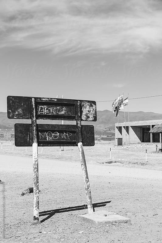 Sign in the middle of the road by Michael Villegas for Stocksy United