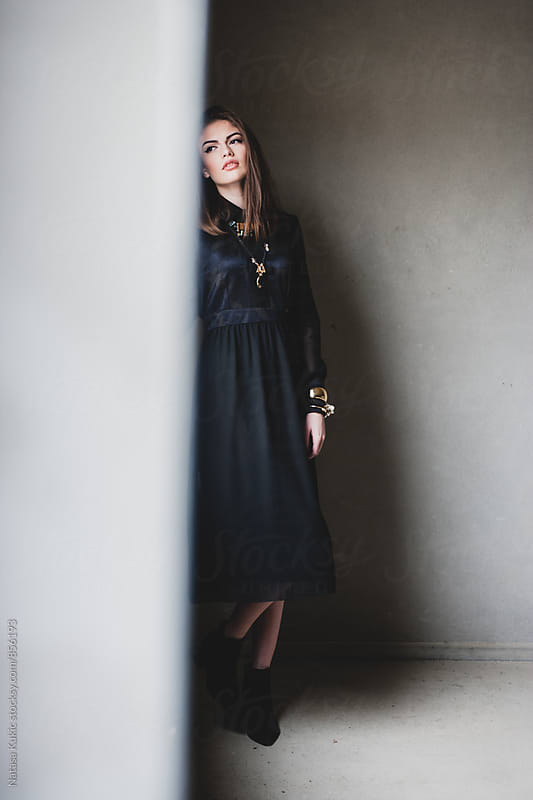 Portraits of a beautiful young woman in a vintage black dress by Natasa Kukic for Stocksy United