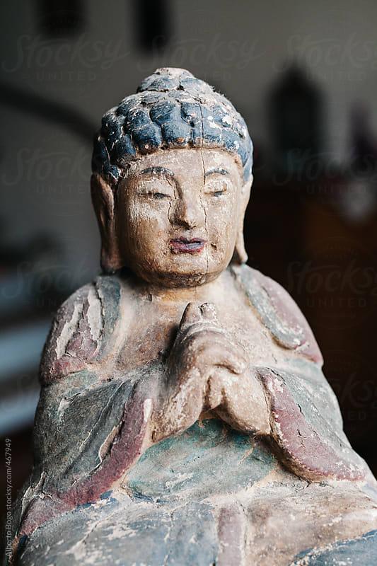 Old Wooden Buddha in Meditation by Alberto Bogo for Stocksy United