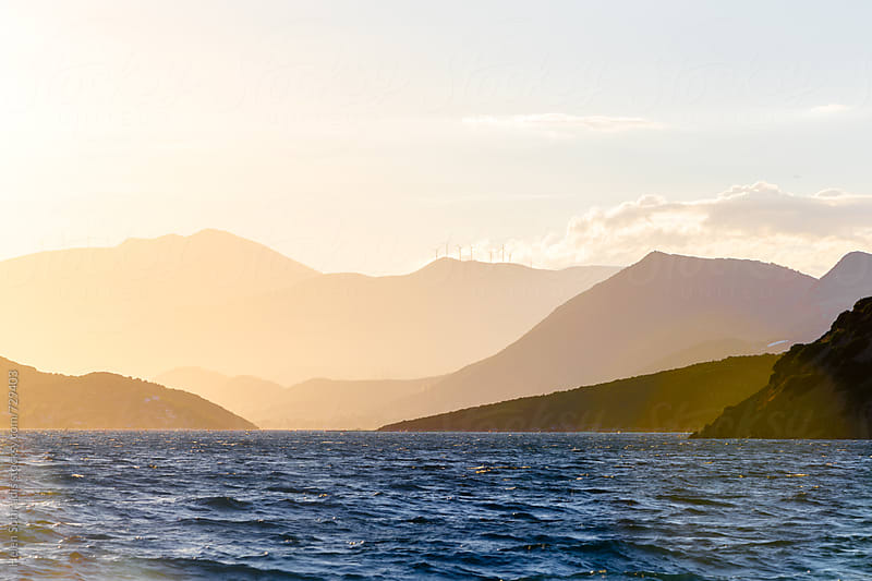 Mountains beyond the Sea at Sunset by Helen Sotiriadis for Stocksy United