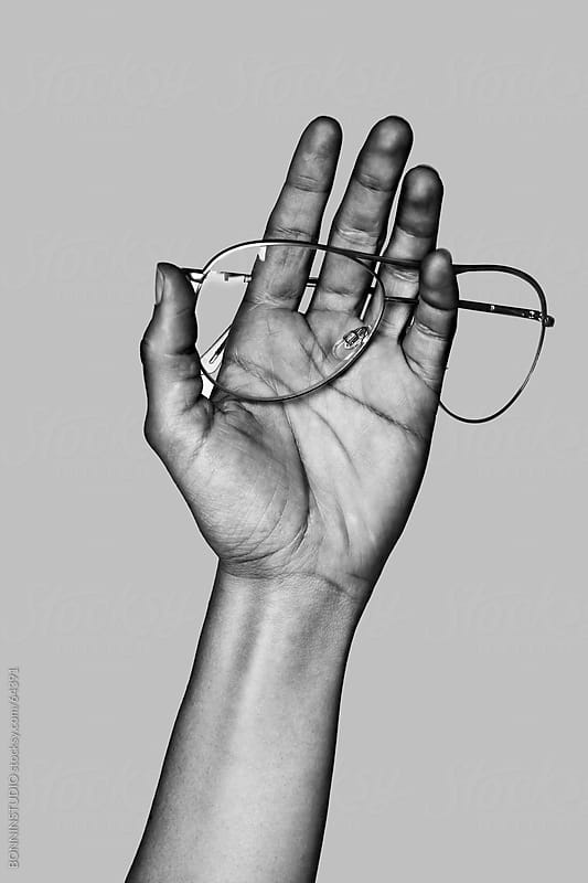 Hand holding vintage glasses. Black and white. by BONNINSTUDIO for Stocksy United