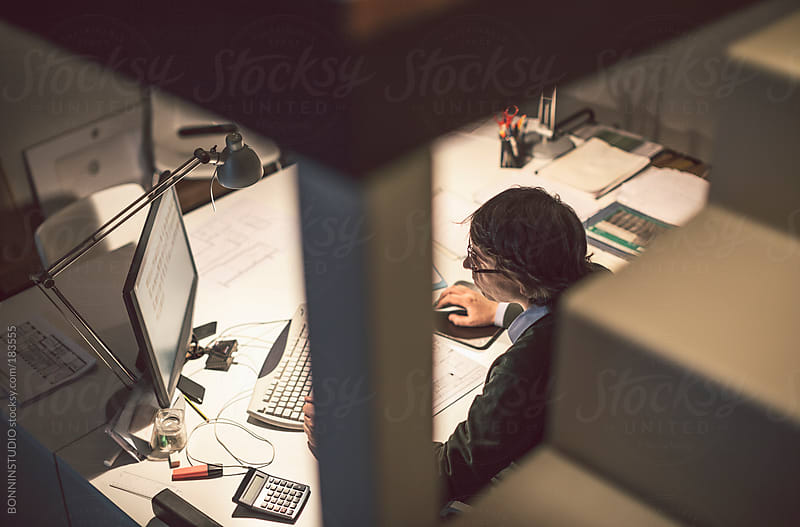 Interior designer man working with computer in his modern studio. by BONNINSTUDIO for Stocksy United