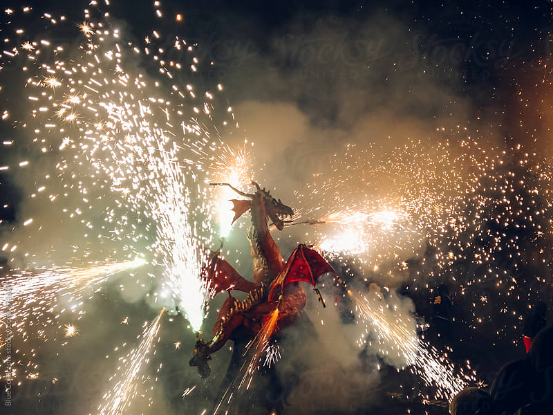 Dragon on the fireworks smoke and sparks by Jordi Rulló for Stocksy United