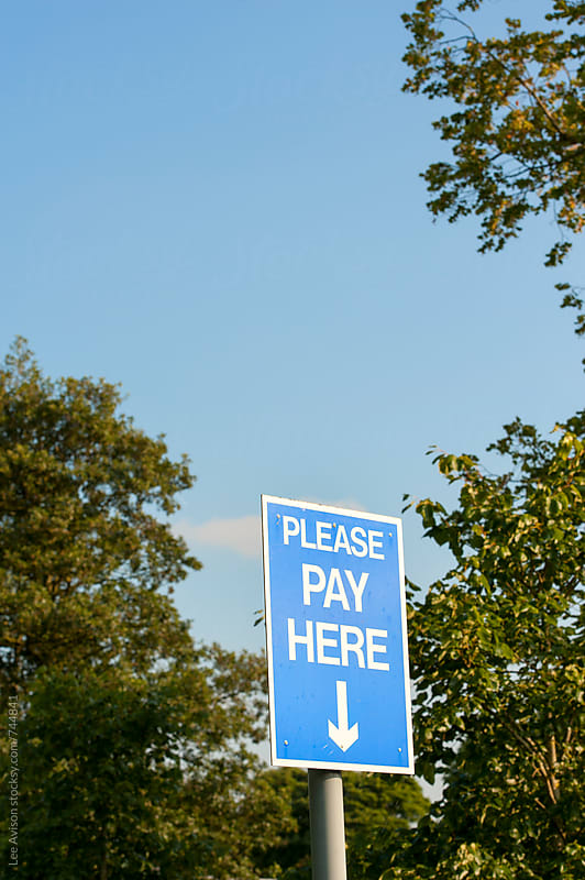 please pay here sign by Lee Avison for Stocksy United