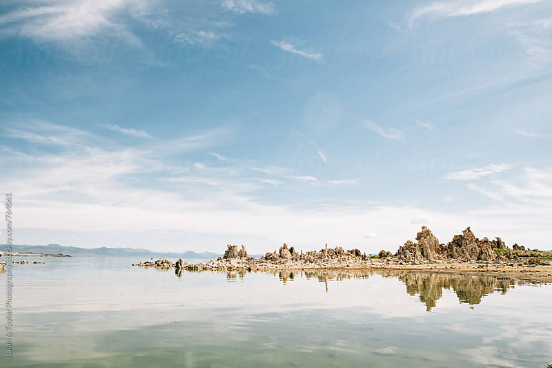 Rock landscape reflection by Isaiah & Taylor Photography for Stocksy United