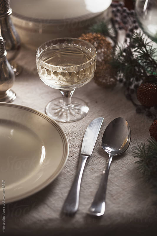 Table set for Christmas night. by mee productions for Stocksy United