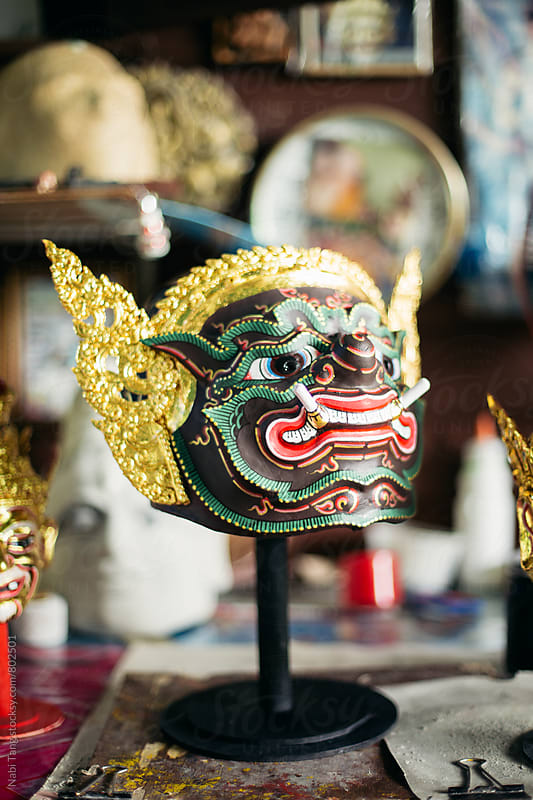 Hand painted 'Phra Phirap' mask for Thai traditional royal stage theater by Nabi Tang for Stocksy United