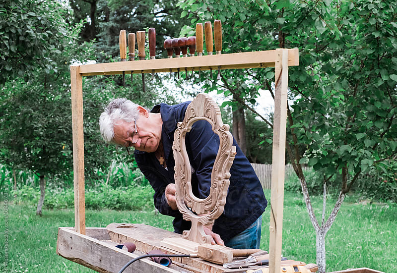 Craftsman Making a Wooden Mirror Frame by Mosuno for Stocksy United