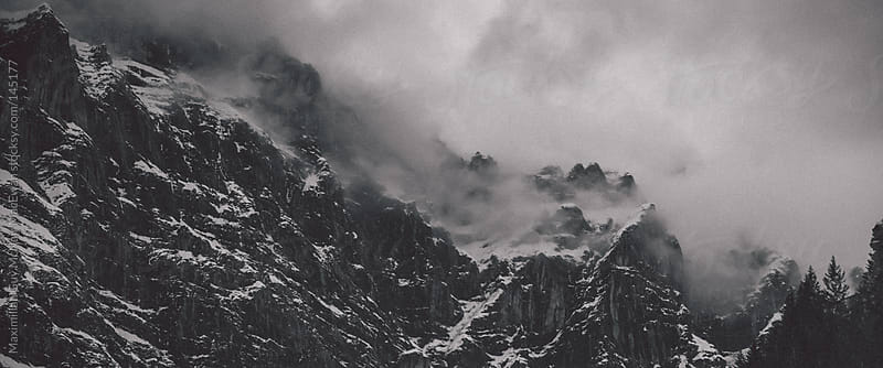Swiss Alps under the cover of cloud by Maximilian Guy McNair MacEwan for Stocksy United