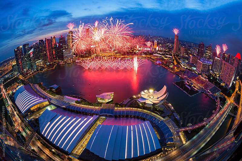 Singapore skyline with Fireworks by Jacobs Chong for Stocksy United