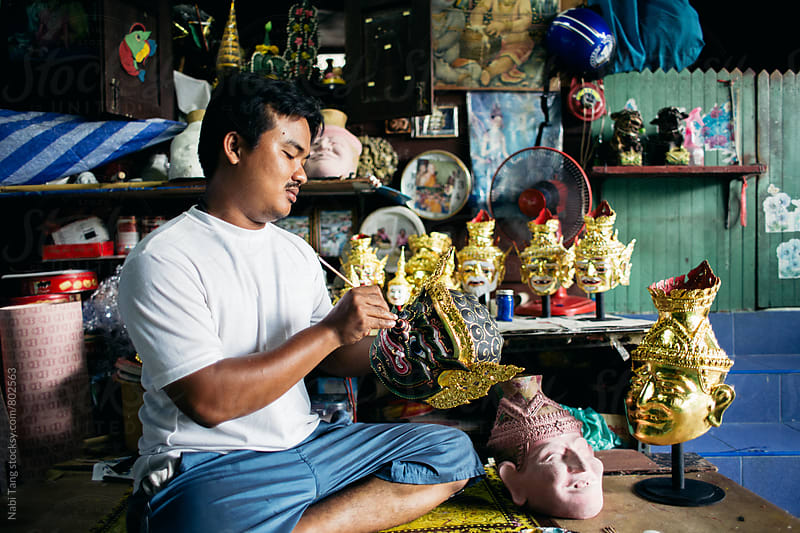 Local artist painting 'Hua Khon' traditional mask for Thai performing arts by Nabi Tang for Stocksy United