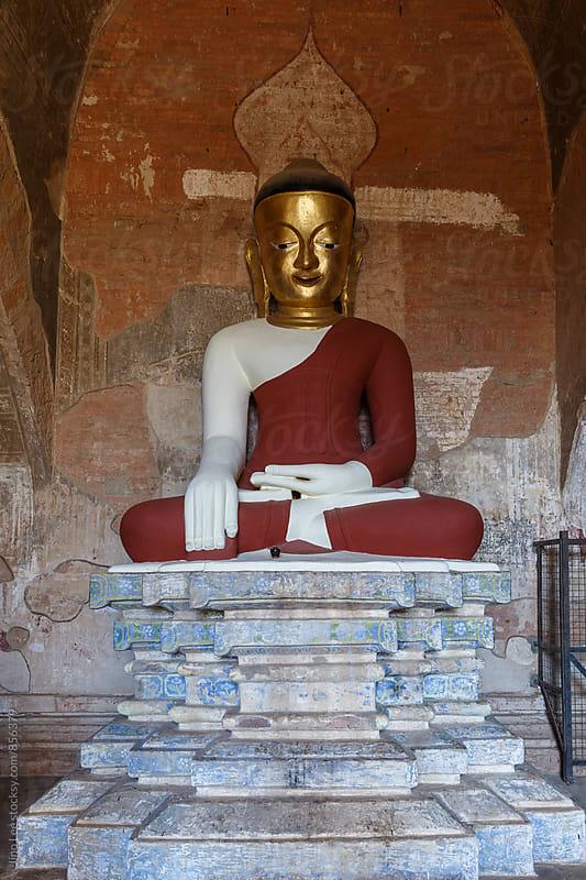 Buddha statue inside Bagan stupa by Jino Lee for Stocksy United