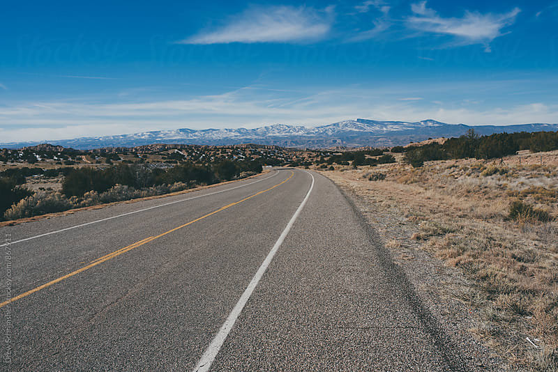 Empty highway with desert landscape  by Drew Schrimsher for Stocksy United