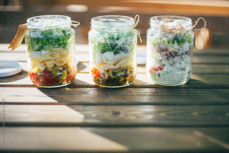 Cute jars filled with a healthy lunch of pasta salad by Jovo Jovanovic for Stocksy United