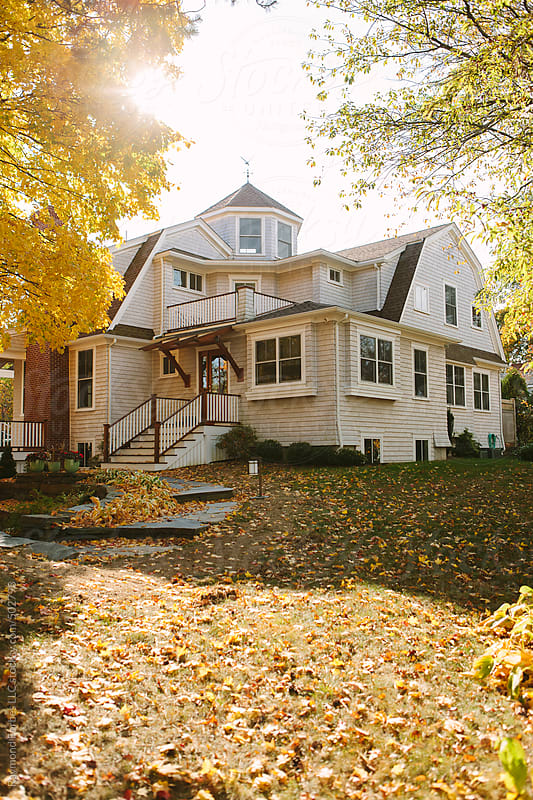Single Family Home in Autumn by Raymond Forbes LLC for Stocksy United