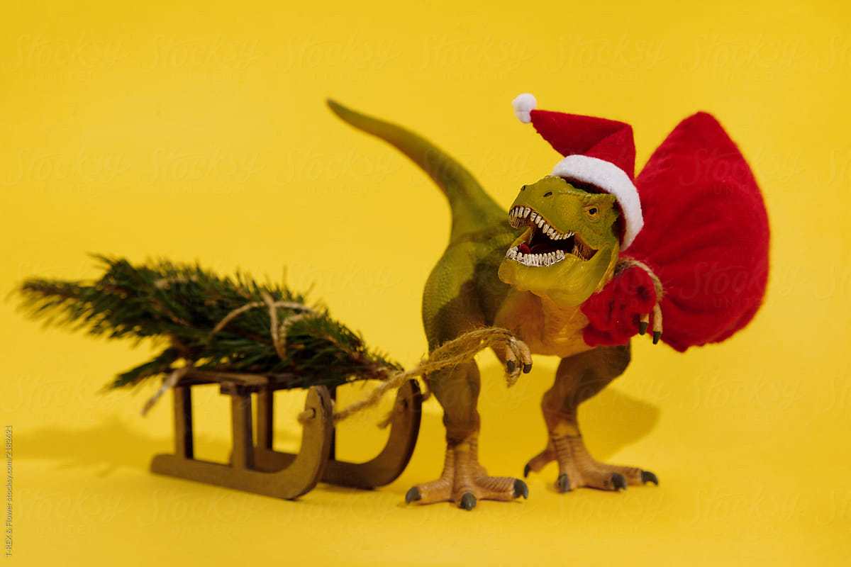 Christmas dinosaur with sledge and bag full of gifts by ...