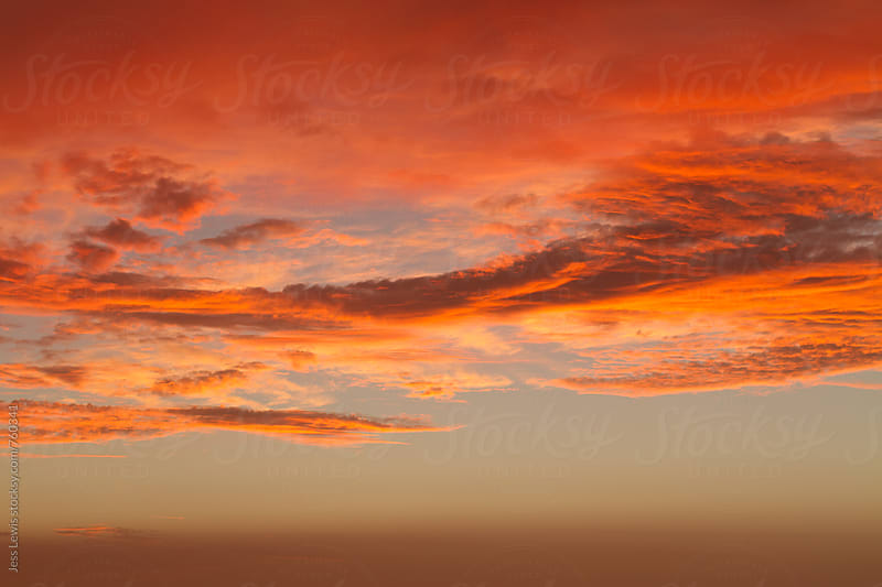 orange and pink clouds at dusk by Jess Lewis for Stocksy United