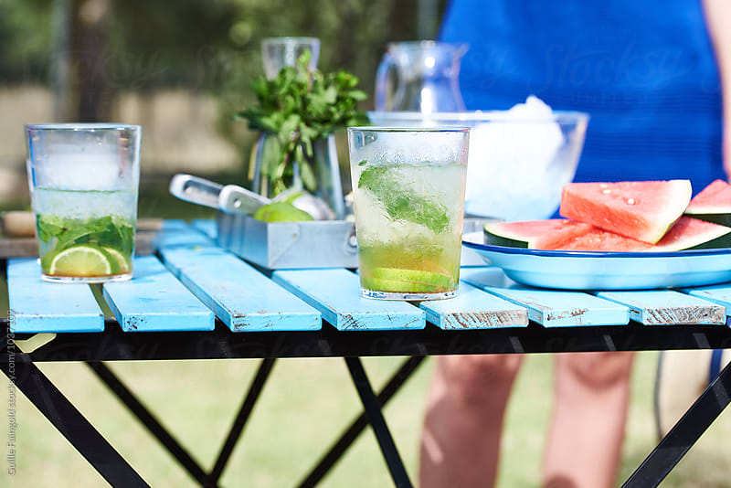 Close-up of outdoor bar with drinks and watermelon