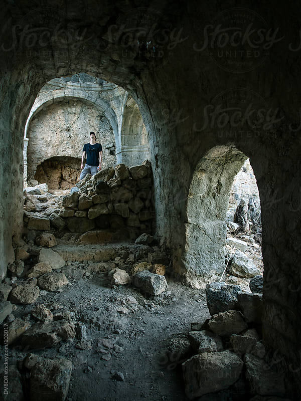 Man looking at a church ruin by DV8OR for Stocksy United