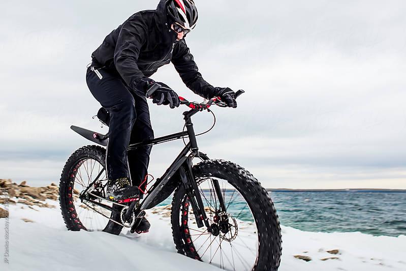 Extreme Winter Sport Mountain Biker Riding Fat Bike In Snow by JP Danko for Stocksy United
