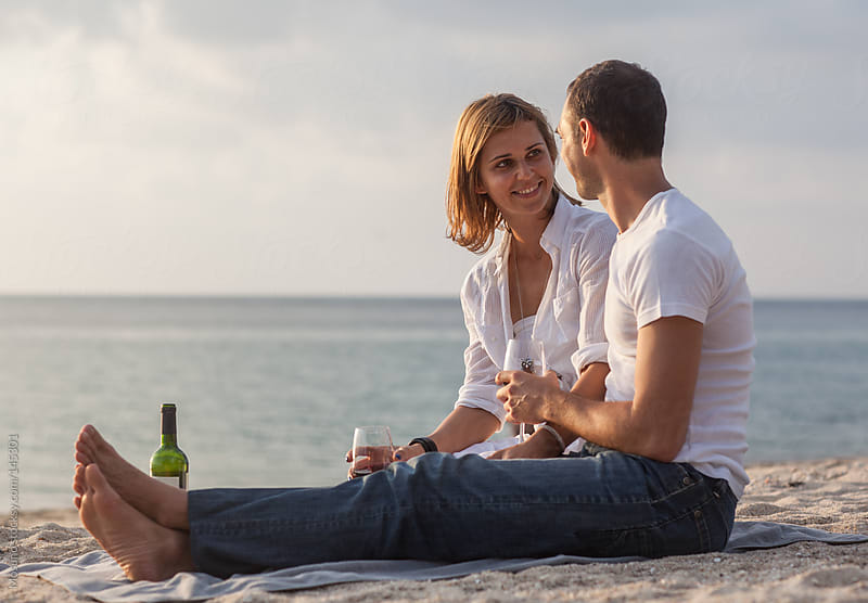 Couple Drinking Wine at the Beach   by Mosuno for Stocksy United