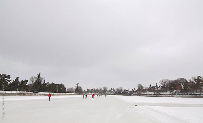 skating on the Rideau canal by Margaret Vincent for Stocksy United