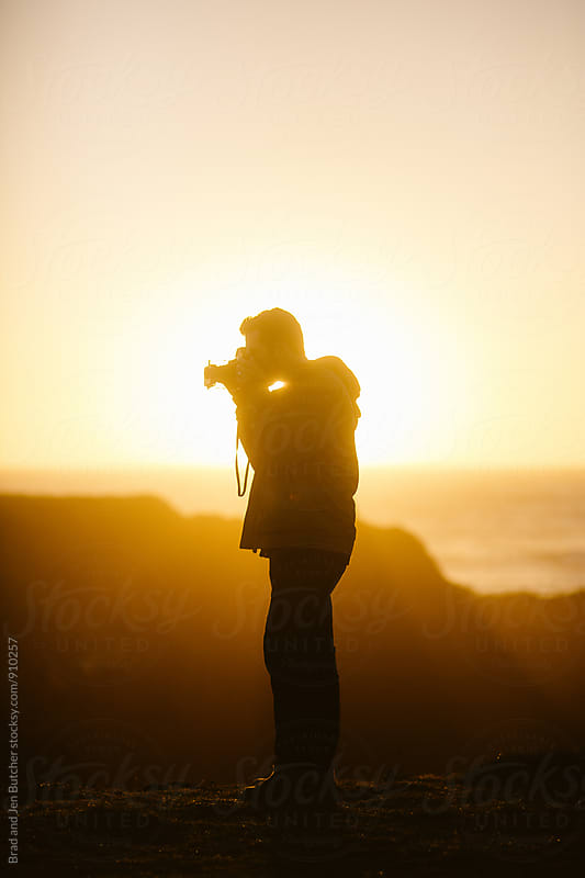 Man's Silhouette in Sunset by Brad and Jen Butcher for Stocksy United