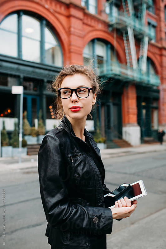 Portrait of young business woman standing in the street  by michela ravasio for Stocksy United