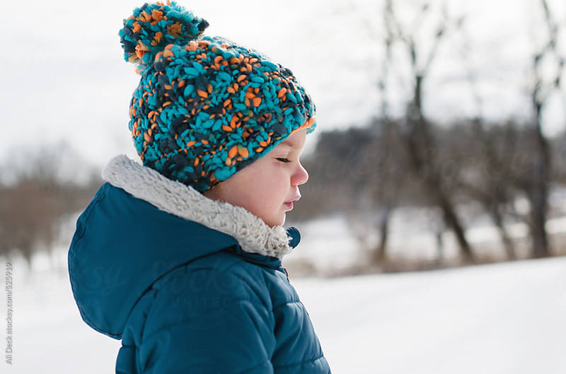 Boy on a Cold and Snowy Day by Ali Deck for Stocksy United