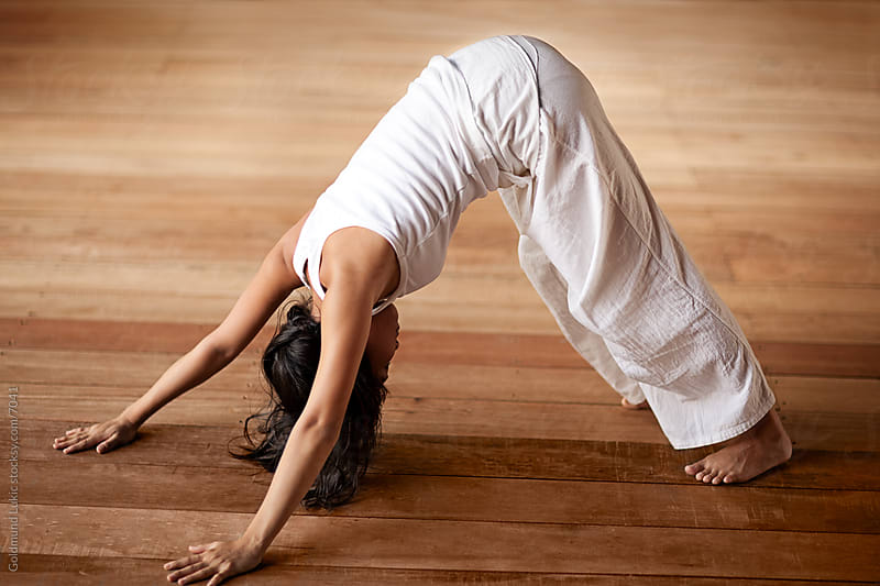 Woman Practicing Yoga by Goldmund Lukic for Stocksy United