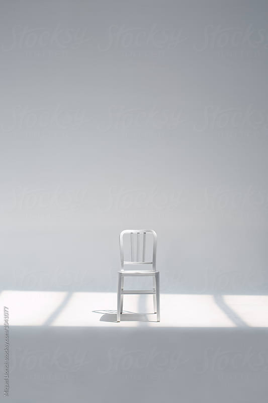 Metallic chair with white background by Miquel Llonch for Stocksy United