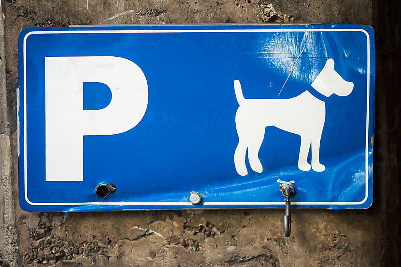 dog parking space,blue sign by Igor Madjinca for Stocksy United