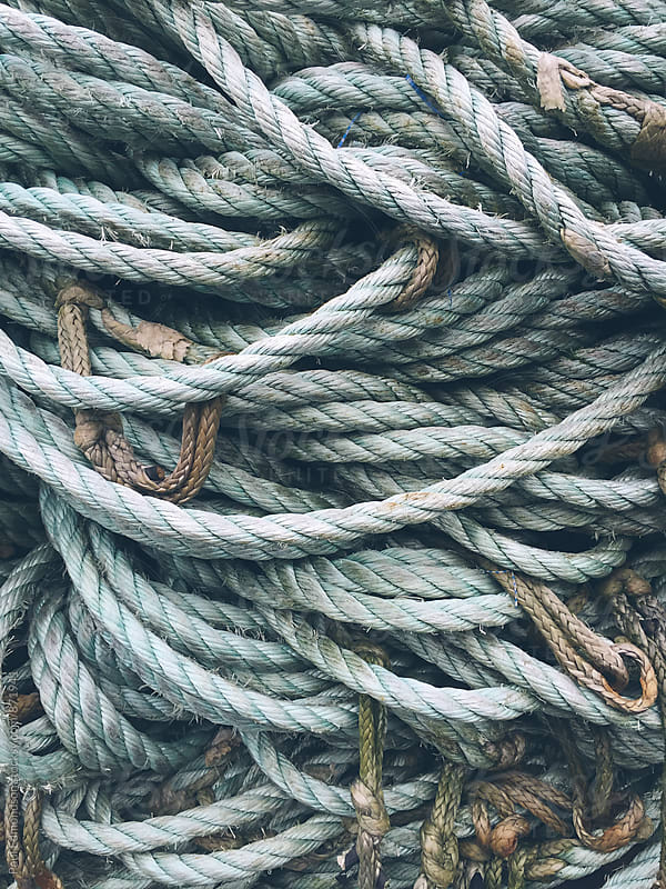 Close up of pile of industrial rope used for commercial fishing by Paul Edmondson for Stocksy United