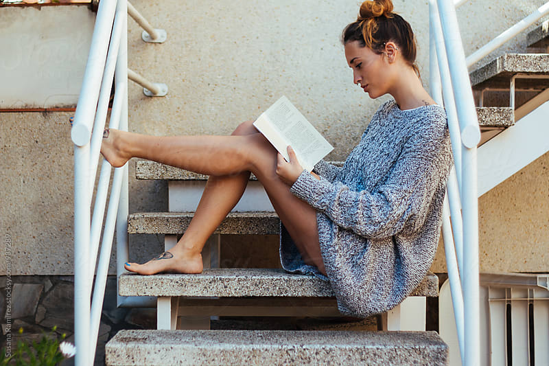 Relaxed woman reading by Susana Ramírez for Stocksy United