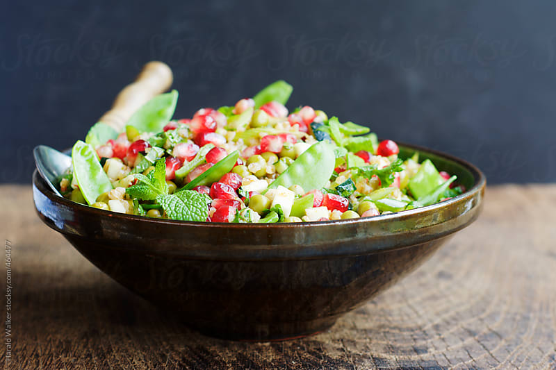 Holiday Bulgur Salad with Pomegranate Arils by Harald Walker for Stocksy United