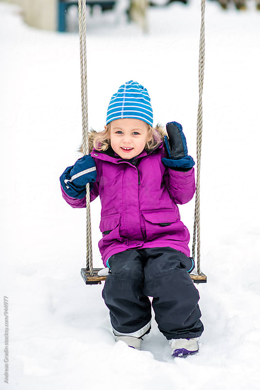 a young girl having winter fun by Andreas Gradin for Stocksy United
