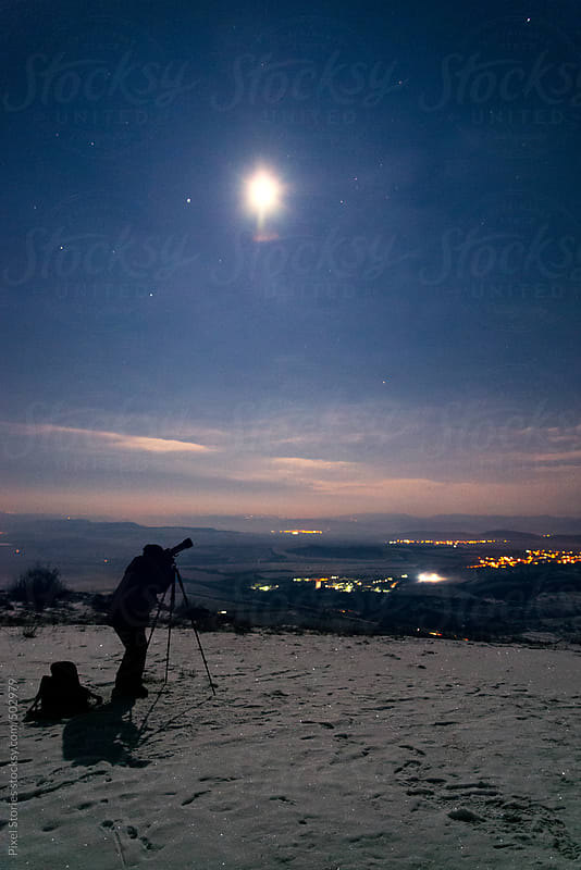 Person taking photo of the night sky by Pixel Stories for Stocksy United