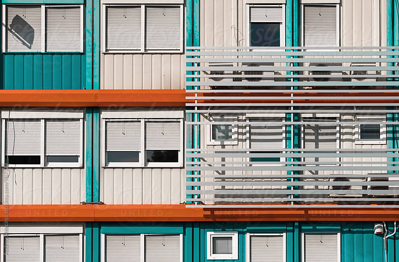 Building facade with blue and orange elements by Audrey Shtecinjo for Stocksy United