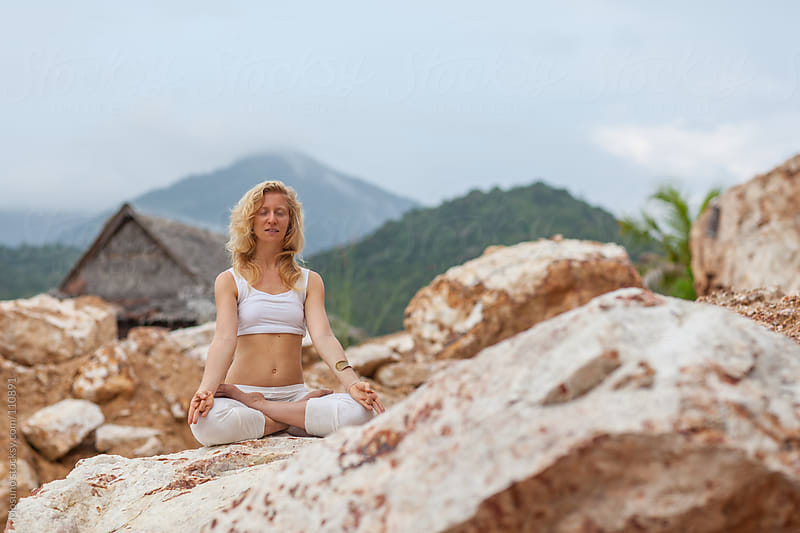 Woman Sitting in Meditation Posture by Mosuno for Stocksy United