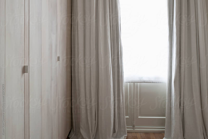 curtains & daylight by Koen Van Damme for Stocksy United