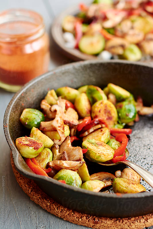 Brussels Sprouts, Mushrooms and Paprikas on Rice by Harald Walker for Stocksy United