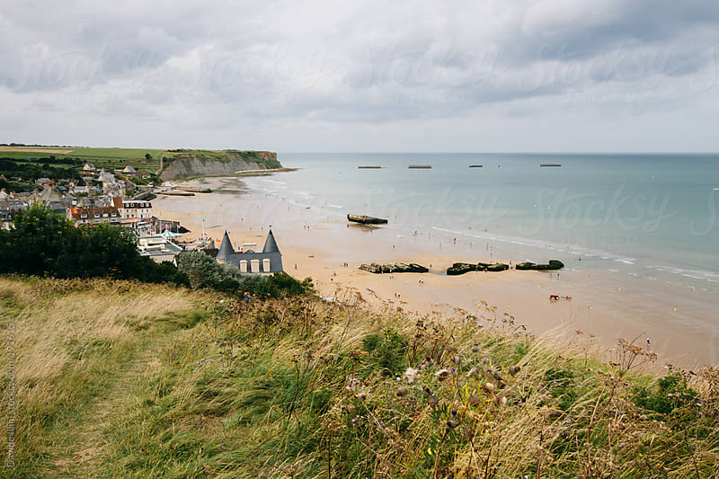 Normandy Landings, remains of artificial port at Arromanches-les-Bains, France by Davide Illini for Stocksy United