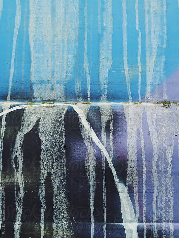 Detail of graffiti and dripping paint on metal train car by Paul Edmondson for Stocksy United