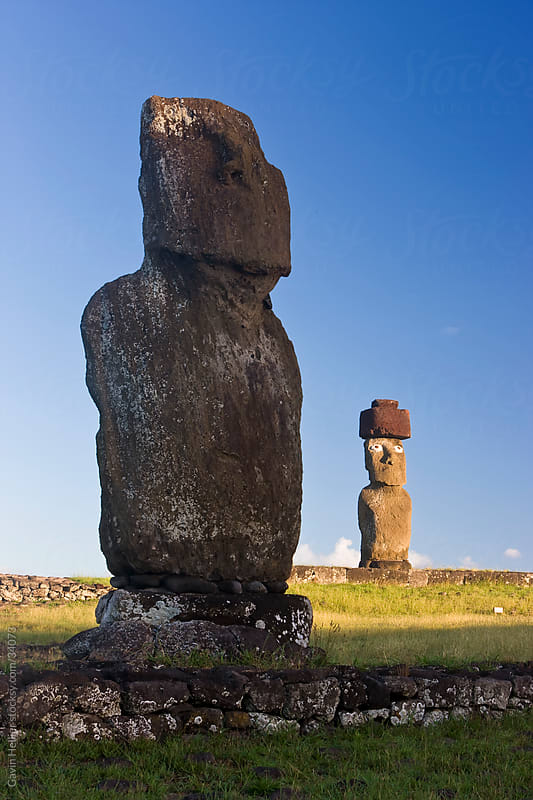 South America, Chile, Rapa Nui, Easter Island, Moai statue Ahu Ko Te riku, the only topknotted and eyeballed Moai on the Island with the statue Ahu Tahai in the foreground by Gavin Hellier for Stocksy United