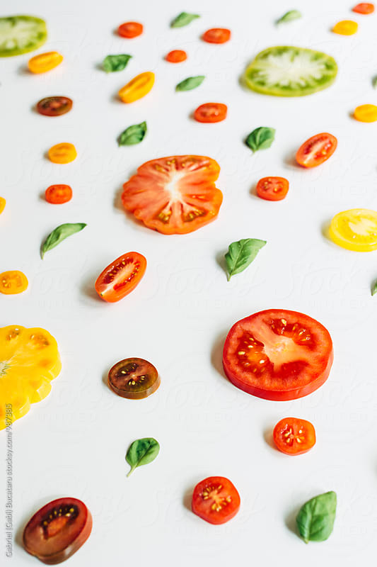 Various tomato slices on a white background by Gabriel (Gabi) Bucataru for Stocksy United