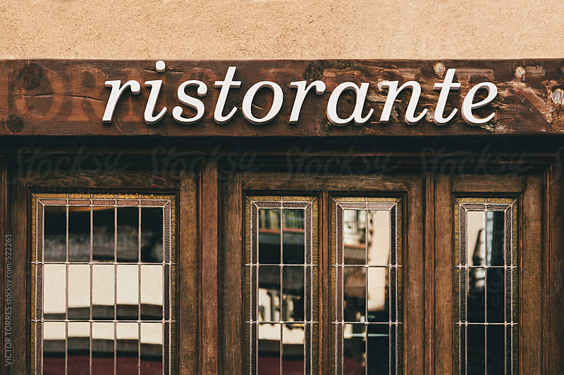 Restaurant Old Sign on a Wooden Facade by VICTOR TORRES for Stocksy United