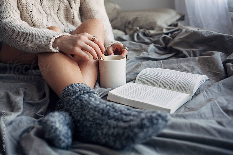 Woman Reading a Book in Bed in the Morning  by Lumina for Stocksy United