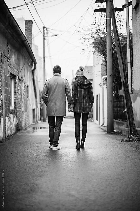 Couple Standing on the Street by Mosuno for Stocksy United